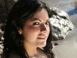Vania does a striptease on the beach
